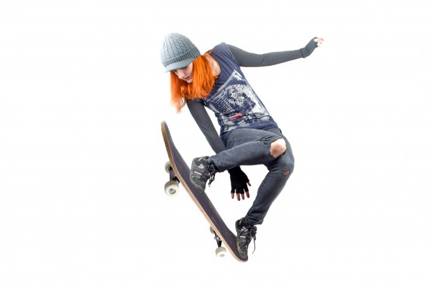 skateboarder-woman-jumping